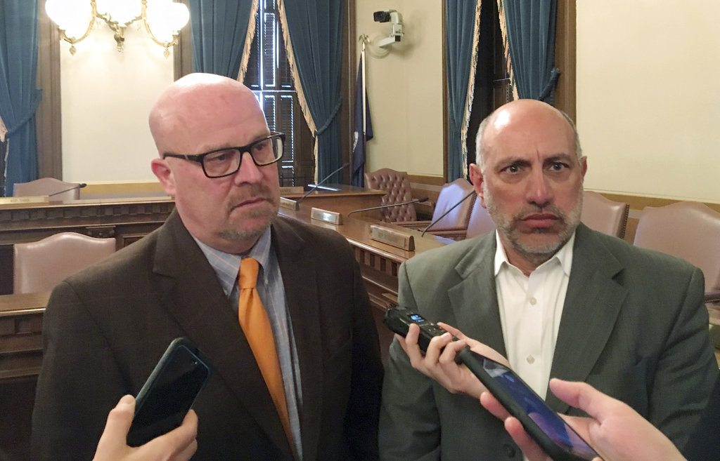 State budget director Al Pscholka, left, and state Treasurer Nick Khouri speak with reporters at the semi-annual revenue-estimating meeting on Thursday, Jan. 11, at the Capitol building in Lansing. Gov. Rick Snyder's administration and Republican lawmakers appear to be headed toward a dispute on cutting state taxes by more than what is being proposed to address an unintended consequence of the federal tax overhaul. (AP Photo/David Eggert)