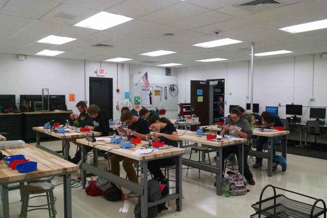 Students at work perfecting their techniques on the practice kits before building actual circuits. Pictured from left, front row: Jake Dulford of Norway; Justin Cescolini of Norway; Jacob Maxon of Iron Mountain; and Clara Irwin of Iron Mountain; second row: Adam Faull of Norway; Tommy Hulce of Norway; and Hunter Damske of Forest Park; third row: Marcus Wheeler of Kingsford; and Hunter Alder of Forest Park.