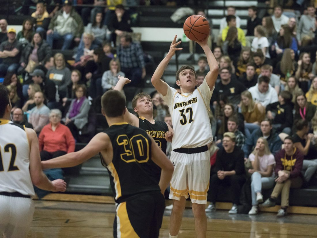 Iron Mountain's Tony Feira (32) shoots against Gwinn on Friday, Jan. 12, 2018, in Iron Mountain, Mich. (Adam Niemi/Iron Mountain Daily News)