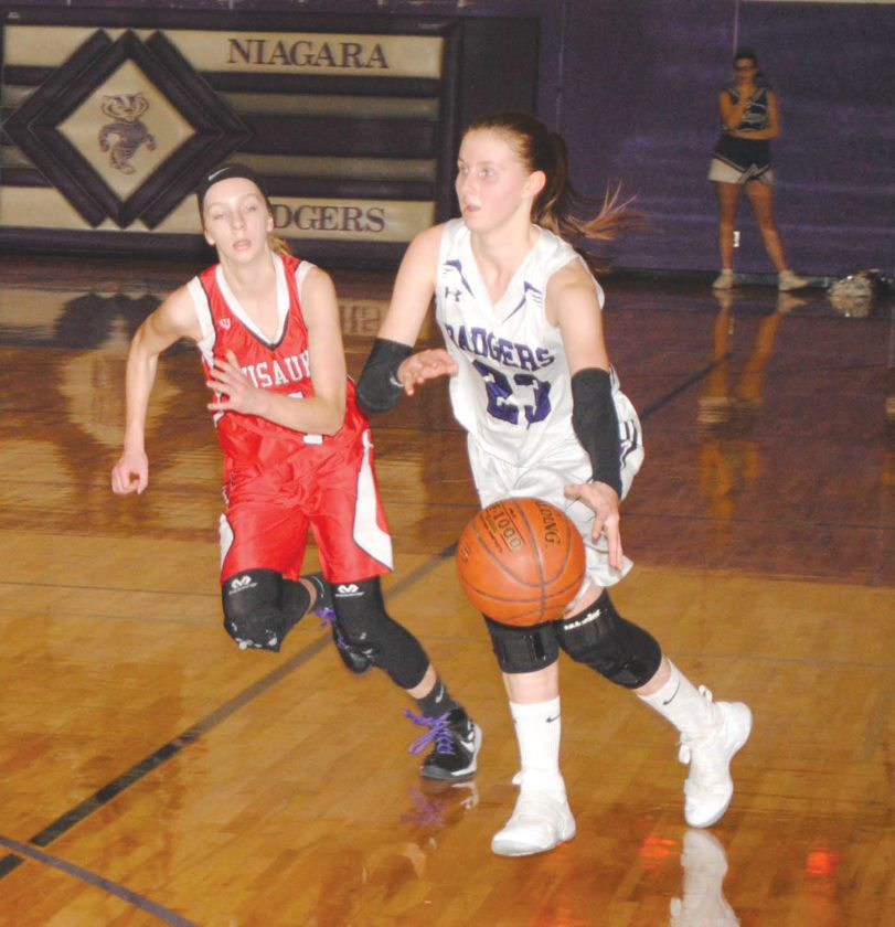 Niagara's Cassie Gill (23) dribbles against Wausaukee's Madelyn Schlies (4) in Friday's M&O Conference game. (Burt Angeli/The Daily News)