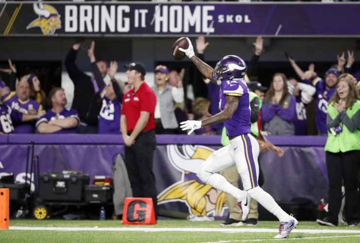 Minnesota Vikings wide receiver Stefon Diggs (14) runs to the end zone for the winning touchdown against the New Orleans Saints during an NFC divisional playoff game Sunday in Minneapolis. The Vikings defeated the Saints 29-24. (AP Photo/Jeff Roberson)