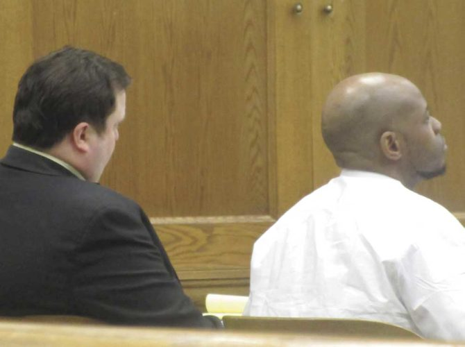 DAMION SINCLAIR, RIGHT, listens to testimony in Dickinson County Circuit Court with his standby counsel, Michael Scholke. (Nikki Younk/Daily News photo)