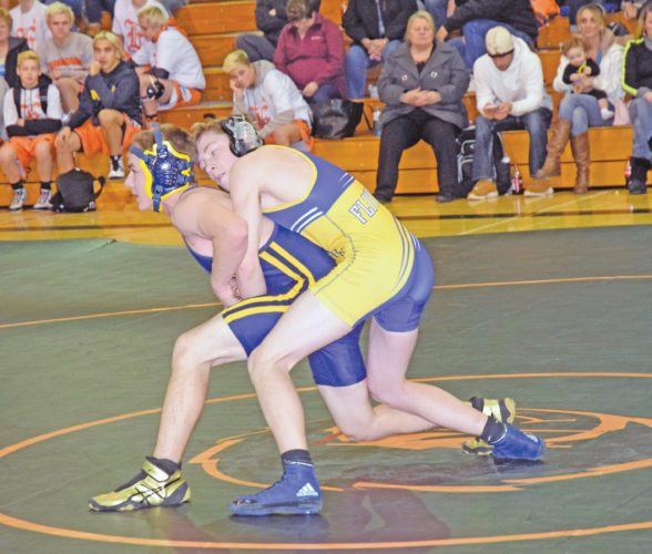 Kingsford's August Early, top, and Negaunee's Jeremy Hill battle for control in a 125-pound bout Wednesday at Escanaba. (Mike Mattson/The Daily Press)