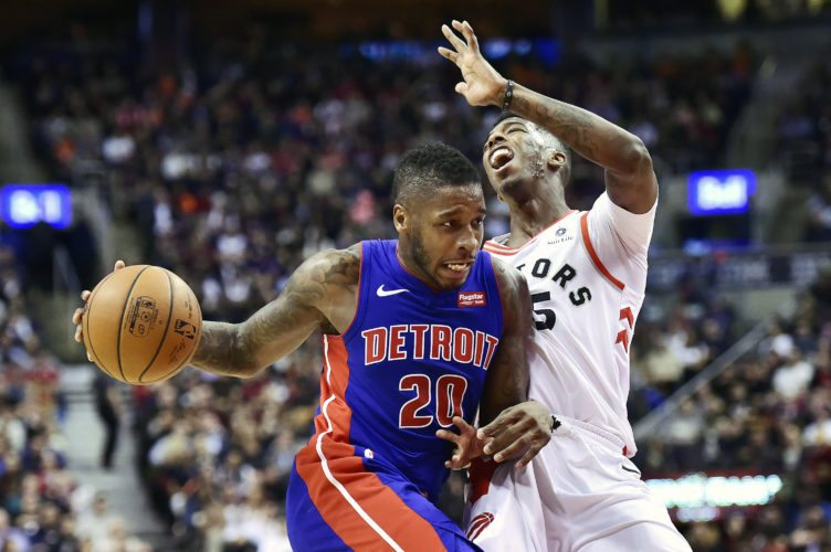 Toronto Raptors guard Delon Wright (55) draws an offensive foul against Detroit Pistons guard Dwight Buycks (20) in Toronto on Wednesday, Jan. 17, 2018. (Frank Gunn/The Canadian Press via AP)