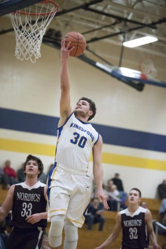 Kingsford's Tyler Beauchamp puts up a shot against North Dickinson on Thursday, Jan. 18, 2018, in Kingsford, Mich. (Adam Niemi/Iron Mountain Daily News)