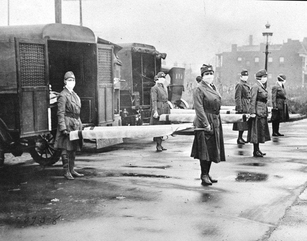 IN THIS OCTOBER 1918 photo, St. Louis Red Cross Motor Corps prepare for victims of the influenza epidemic. (Library of Congress via AP)