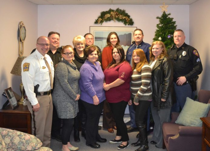 THE Dickinson County new forensic interview room recently opened at The Caring House in Iron Mountain. Shown in the front row, from left are Dickinson County Sheriff Scott Rutter, Tara Trudgeon, Caring House; Donna Fayas-Johnson, Caring House; Mellisa Lantto, Caring House; Marti Swisher, Caring House; Connie Larson, Dickinson County Prosecutor's Office; back row: Ed Mattson, Iron Mountain Police Department; Caring House Executive Director Cheryl O'Neil, Jim Shafer, Norway City Police; Dickinson County Chief Assistant Prosecutor Kristin Kass, Geno Basanese, Michigan State Police; Tim Olson, Kingsford Public Safety. (Chris Tomassucci/Daily News Photo)