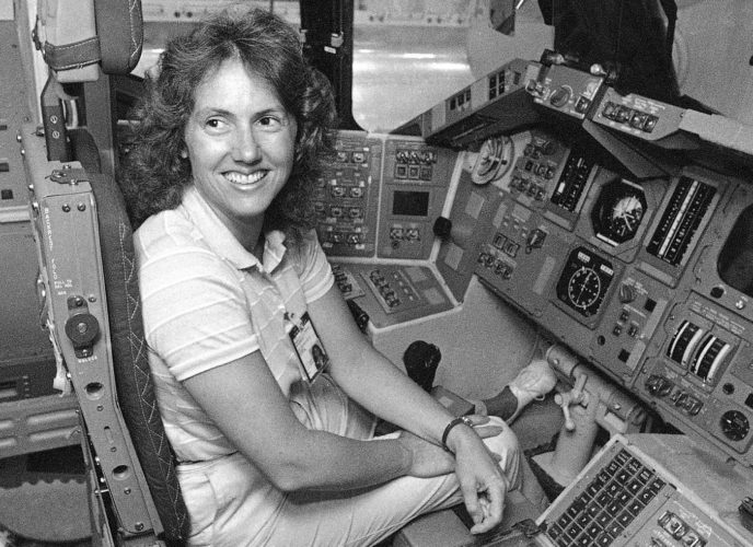 AP Photo In this Sept. 13, 1985 file photo, Christa McAuliffe tries out the commander's seat on the flight deck of a shuttle simulator at the Johnson Space Center in Houston, Texas. Thirty-two years after the Challenger disaster, a pair of teachers turned astronauts on the International Space Station will pay tribute to McAuliffe by carrying out her science classes.