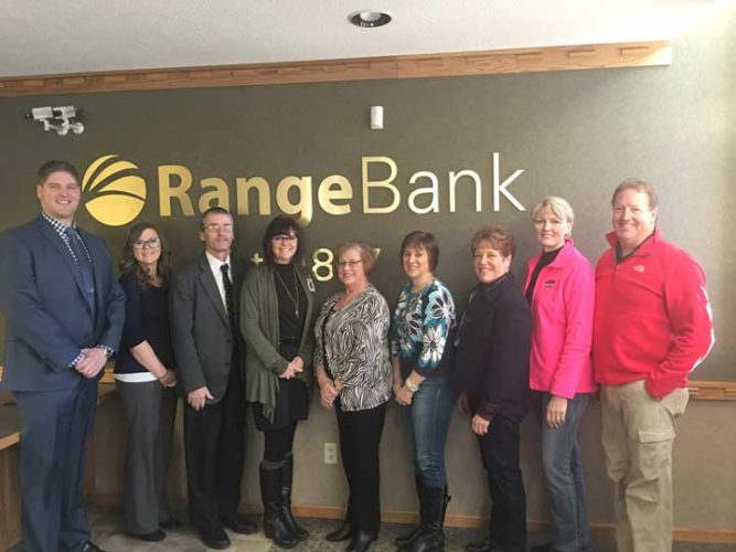 RANGE BANK RECENTLY became a title sponsor of the 2018 Dickinson Area Chamber Alliance's annual event, Casino Royale at the Ritz. From the left are Benjamin Wood, Range Bank Community Bank president; Kandace Smith, Range Bank customer service; Christopher DeRoche, Range Bank vice president and loan officer; Ritz Committee members Teresa Schettler, Barb Bigelow, Julie Olson and Lynda Zanon; and Suzanne Anderson and Todd Lysinger, co-chairpersons for the event.
