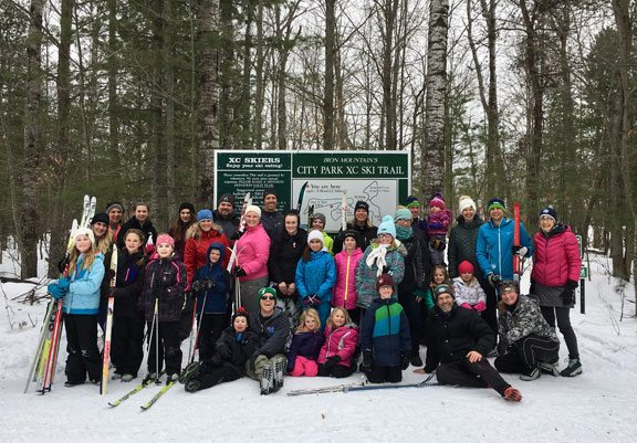 Pictured at a youth ski league gathering at City Park in Iron Mountain are, from left, front, Josiah Ringel, Jonathan Ringel, Luciana Whaley, Parker Whaley, David Nelson, John Nienstaedt, Dr. Sarah Venditti; and, standing, Emma Dube, Ashley Weeks, Jodie Gilroy, Elizabeth Romitti, Maggie Menghini, Myah Gilroy, Mackenzie Gilroy, Dr. Alexis Whaley, Isaac Nelson, Jeff Gilroy, Kathy Nelson, Mike Nelson, Emily Nelson, Ava Weeks, Andrew Nelson, Elena Nelson, Nancy Arcand, Laylonie Sexton, Beth Sexton, Brandon Maki, Holland Maki, Halle Maki, Amanda Krznarich, Lucy Krznarich, Dan Krznarich and Amy Giesen. (Glady Van Harpen Photo)