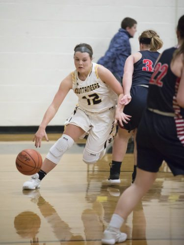 Iron Mountain's Saylor Swartout, left, drives to the basket against Westwood on Tuesday, Feb. 6, 2018, in Iron Mountain, Mich. (Adam Niemi/Iron Mountain Daily News)