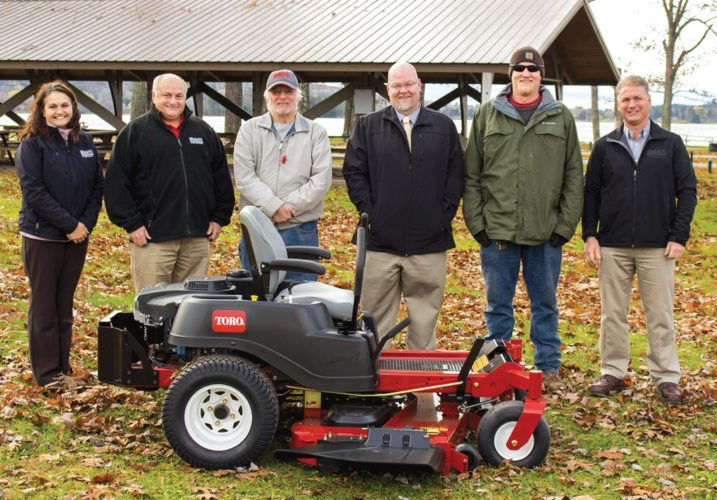 FIVE DICKINSON COUNTY area entities, including Lake Antoine Park, were awarded equipment from BOSS Snowplow through the annual Toro Product Donation Program. From left are Justina Blazier, giving ambassador, BOSS Snowplow; Joe Jaeger, controller, BOSS Snowplow; Joe Stevens, Dickinson County commissioner; Brian Bousley, Dickinson County controller;  Eric Robinson, Lake Antoine park manager; and Jody Christy, president, BOSS Snowplow.