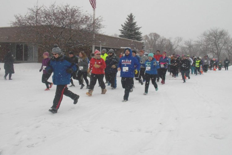 Wintry weather didn't stop runners Saturday in the Dickinson-Iron Community Services Agency's (DICSA) Frosty 5K & Merry Mile at Iron Mountain Senior Center.