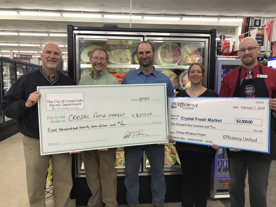 TWO GRANTS HELPED Crystal Fresh Market replace its refrigeration cases with more energy-efficient equipment. From left are Ross Tresedder, Crystal Fresh Market owner; Jeff Forbes, WPPI Energy Services representative; Dave Graff, Crystal Falls Electric Department manager; Lindsay Wagner, Efficiency United Energy advisor; and Zack Stuck, Crystal Fresh Market store manager.
