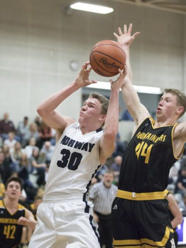 Norway's Kody Hendricks, left, puts up a shot as Iron Mountain's Charlie Gerhard defends on Friday, Feb. 9, 2018, in Iron Mountain, Mich. (Adam Niemi/Iron Mountain Daily News)