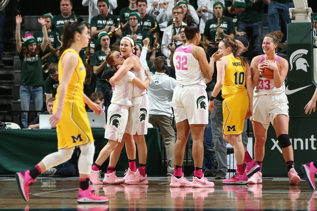 Matt Mitchell/MSU Athletic Communications  Former Forest Park star Lexi Gussert embraces Michigan State teammate Taryn McCutcheon after the Spartans defeated Michigan on Sunday in East Lansing.