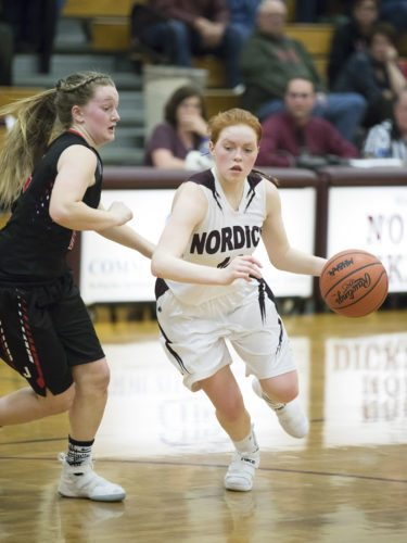 North Dickinson's JuliAnn Wickman drives to the basket against North Central on Monday, Feb. 12, 2018, in Felch, Mich. (Adam Niemi/Iron Mountain Daily News)