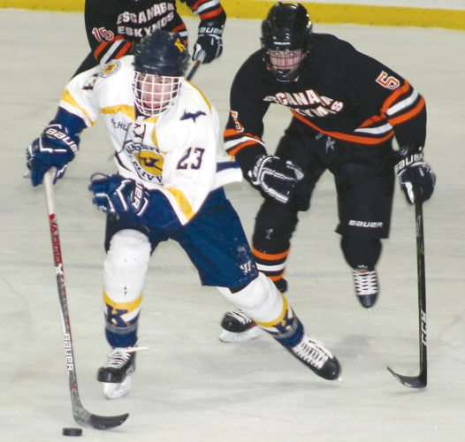 Escanaba's Grant LaMarche (5) chases Kingsford's David Brule (23) on Tuesday in Iron Mountain. (Theresa Proudfit/The Daily News)