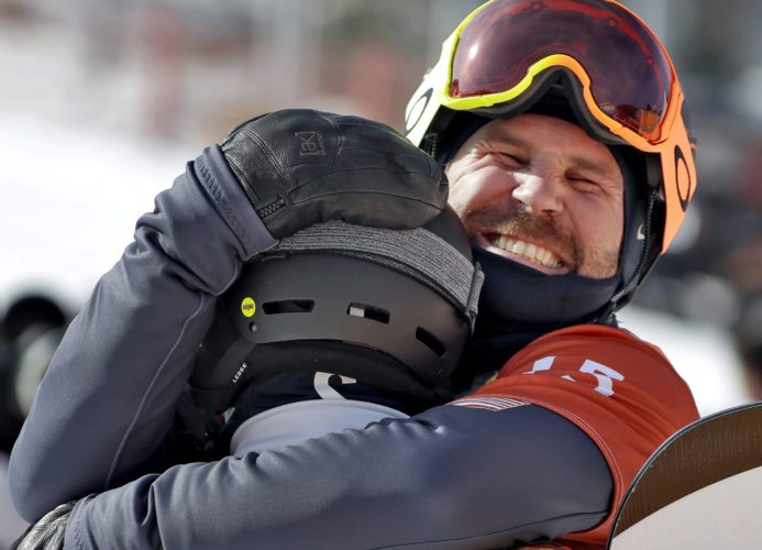 Nick Baumgartner, of the United States, right, hugs Mick Dierdorff, of the United States, after the men's snowboard cross semifinals at Phoenix Snow Park at the 2018 Winter Olympics on Thursday in Pyeongchang, South Korea. (AP Photo/Gregory Bull)