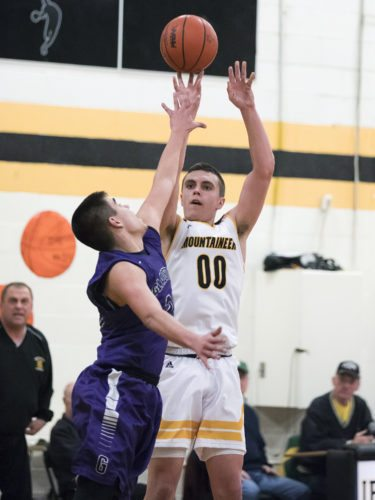 Iron Mountain's Foster Wonders shoots over a Gladstone defender on Thursday, Feb. 15, 2018, in Iron Mountain, Mich. (Adam Niemi/Iron Mountain Daily News)