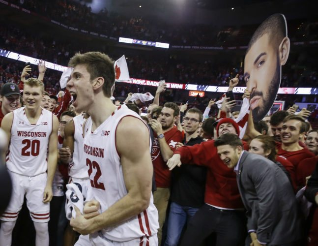 Wisconsin's Ethan Happ (22) celebrates with teammates and fans after Wisconsin upset Purdue 57-53 on Thursday, Feb. 15, 2018, in Madison, Wis. Happ had a team-high 21 points. (AP Photo/Andy Manis)