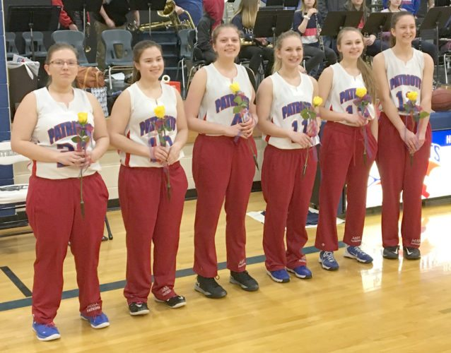"Goodman-Pembine honored girls basketball seniors Kayley White (from left), Madison McLain, Heather Geib, Kirstyn Gardner, Harlee Davis and Rachel Braaten at Friday's game with Mercer. ""Our six graduating seniors have contributed at a very high level this season,"" said Coach Stefanie Goyak."