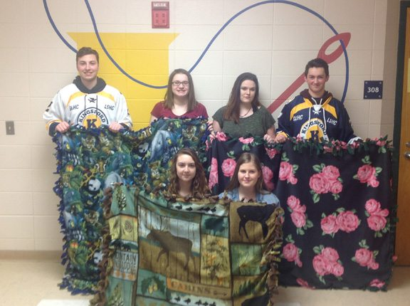 "Students from the Kingsford High School child development class made blankets for cancer patients at Dickinson County Healthcare System. Funds raised at tonight's ""Pink the Rink"" event at Mountain View Ice Arena will benefit the program. From left, back, are Sawyer Perpich, Adrien King, Sierra Strickland and Nick Murvich; in front are Jordan Polkinghorne and Erika Pollock."