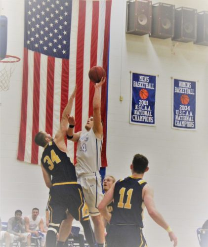Austin Carlson of Finlandia University goes up for a shot in Saturday's game versus Lakeland College at Paavo Nurmi Gym. The Lions dropped their season finale 88-70. (Paul Peterson photo)