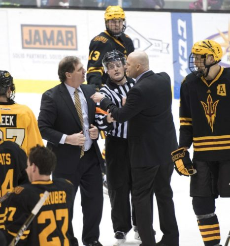 David Archambeau/ Daily Mining Gazette Michigan Tech coach Joe Shawhan and Arizona State assistant Alex Hicks exchange words after Tech's 5-3 win over ASU Saturday at the MacInnes Student Ice Arena. Moments later, Hicks and head coach Greg Powers had Shawhan in a headlock. Powers and Shawhan eventually had to be separated by officials.