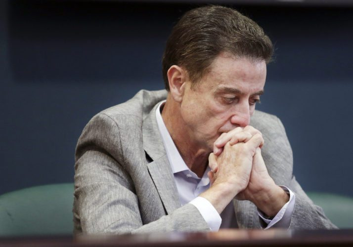 In this June 15, 2017 photo, Louisville basketball coach Rick Pitino listens during a news conference in Louisville, Ky. Louisville must vacate its 2013 men's basketball title following an NCAA appeals panel's decision to uphold sanctions against the men's program for violations committed in a sex scandal. The Cardinals will have to vacate 123 victories including the championship, and return millions in postseason revenue. The decision announced on Tuesday, Feb. 20, 2018, by the governing body's Infraction Appeals Committee ruled that the NCAA has the authority to take away championships for what it considers major rule violations. (Alton Strupp/The Courier-Journal via AP, File)
