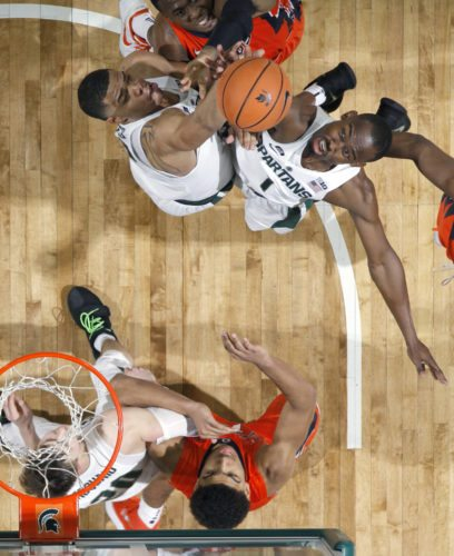 Michigan State's Joshua Langford, top right, and Miles Bridges, top left, and Illinois' Leron Black, top center, reach for a rebound as Michigan State's Matt McQuaid, bottom left, and Illinois' Mark Smith watch on Tuesday, Feb. 20, 2018, in East Lansing, Mich. (AP Photo/Al Goldis)