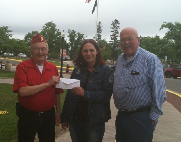 Bay College West student Kimberly Thomas receives a $400 scholarship from Ray Hamm, left, chairman of the Dickinson County Area Veterans Alliance, and alliance member Ken Davis. Thomas submitted an essay on sacrifices of soldiers in World War I and was scheduled to read her work as part of the DickinsonCounty Memorial Day program, but was canceled due to weather. Thomas is an honor student at Bay West and is majoring in social work at Lake Superior State University through Bay.