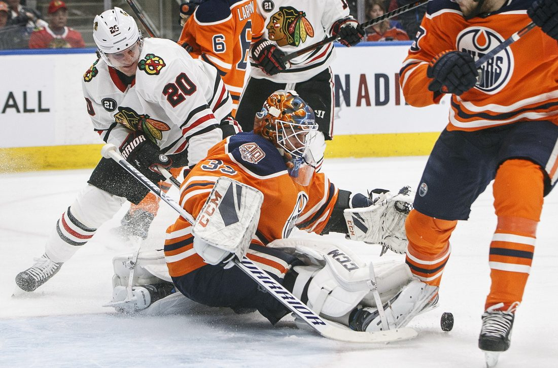 Hawks blow past Oilers in 3rd to win 5th in a row
