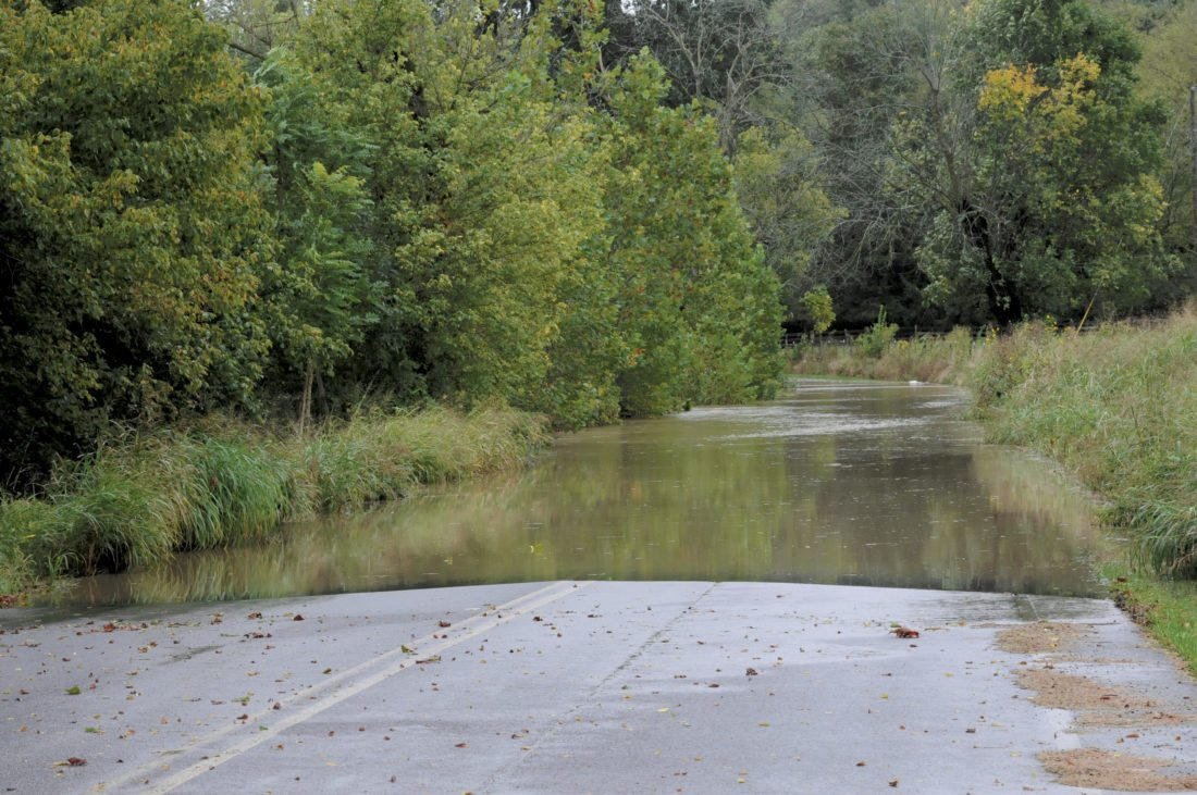The Opequon Creek has flooded closing Douglas Grove Road Thursday afternoon in Martinsburg. (Journal Photo by Ron Agnir)
