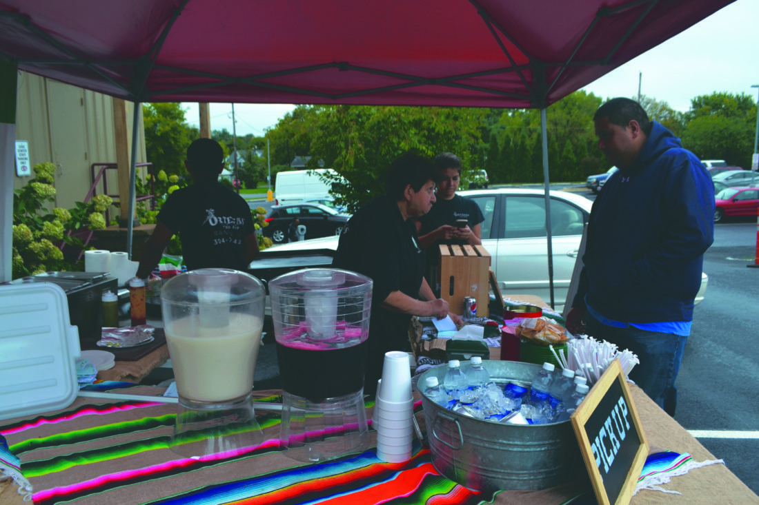 Journal photo by Mary Stortstrom An attendee of the Hispanic Heritage Festival orders a plate of tacos from Ortega's Taco Shop, located in Ranson. Hispanic foods, music and culture was highlighted at the festival, held Saturday at the Ranson Civic Center.