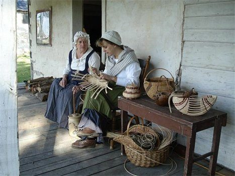 Submitted photo Reinactors work on baskets, preparing for today's Harvest Faire at the Peter Burr Farm Historic Site.
