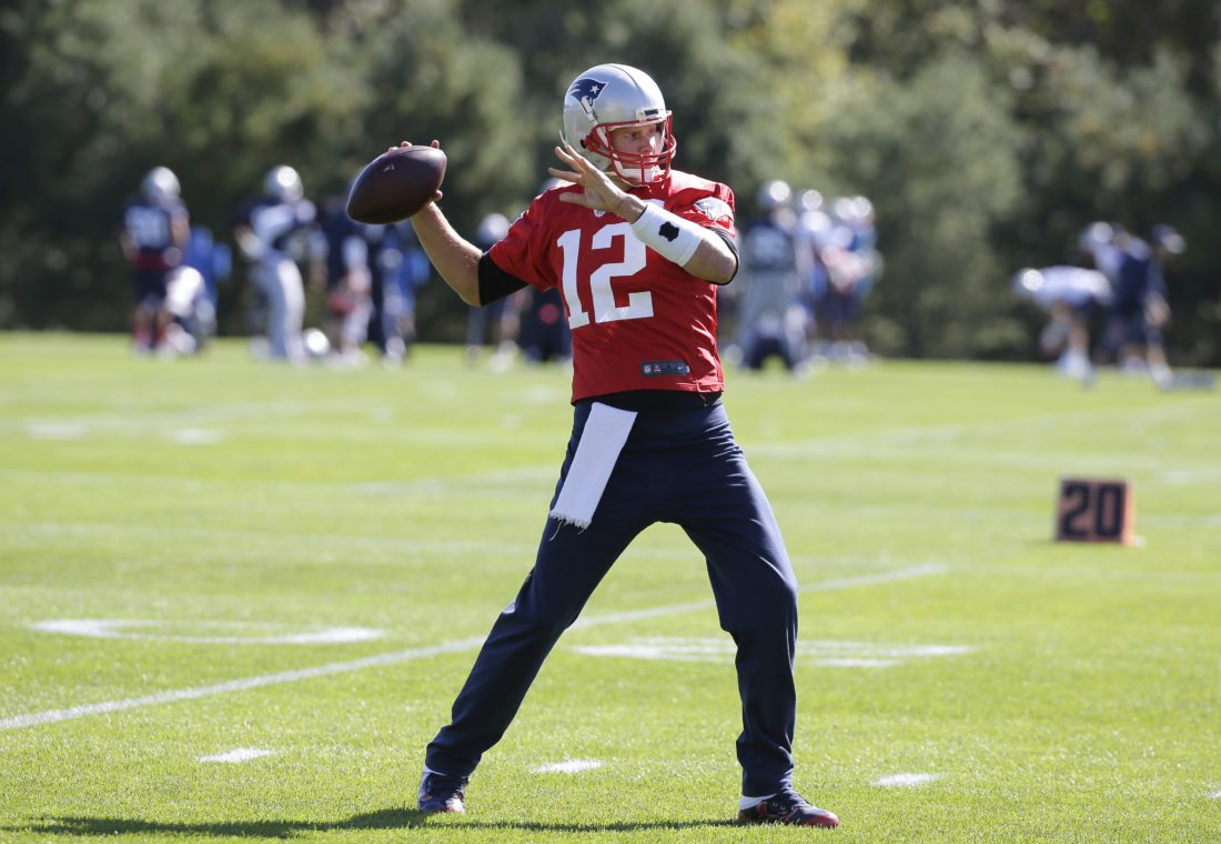 New England's Tom Brady winds up for a pass during the Patriots' practice Wednesday in Foxborough, Mass.