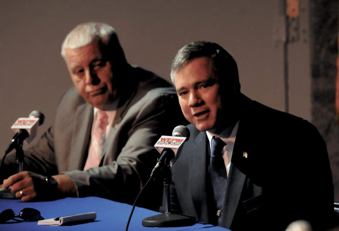 """Journal photo by Ron Agnir Gary """"Peanut"""" Collis, left, and S. Marshall Wilson listen to panel questions during the political forum for the West Virginia House of Delegates 60th District, held at the Apollo Civic Theatre."""