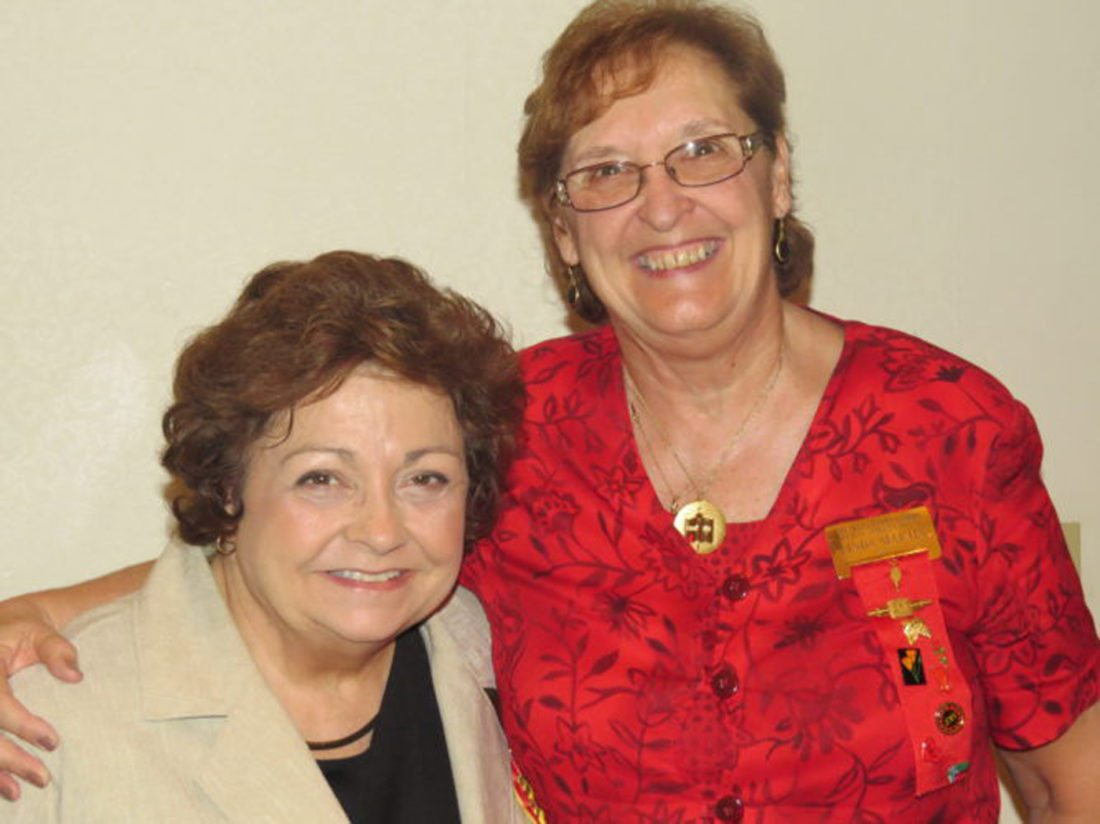"Submitted photo Pictured are Dr. Marilyn ""Susie"" Rogers, left with Linda Martin, right, wearing the necklace that symbolizes the achievement award."