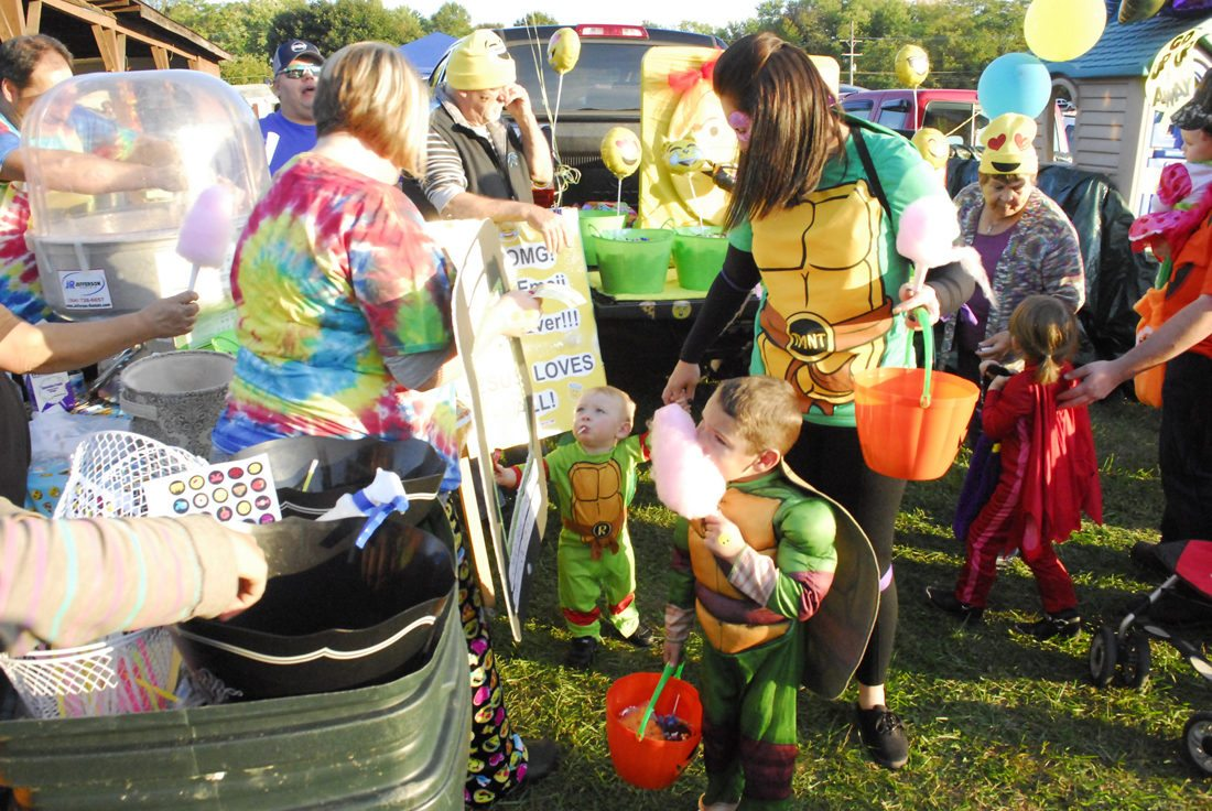 "Journal photo by Jeff McCoy Heather Hunt, of Martinsburg, right, stands with her children Rylan, 4, and Easton, 1, both as Teenage Mutant Ninja Turtles, on Saturday at the ""Trunk-or-Treat"" in Kearneysville."