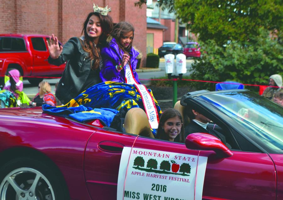 2016 Miss West Virginia Morgan Breeden rides in the parade.