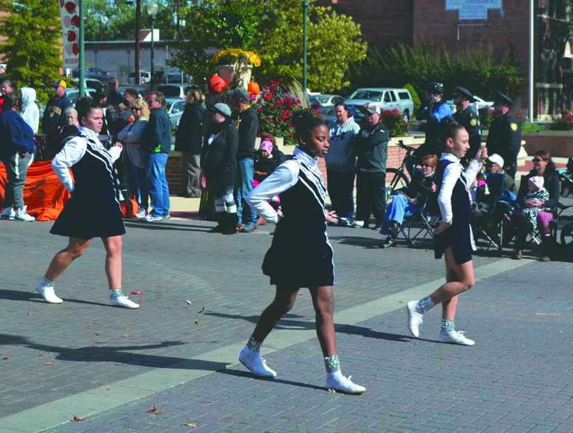 Members of the Silver Starlettes Color Guard participate in the parade.
