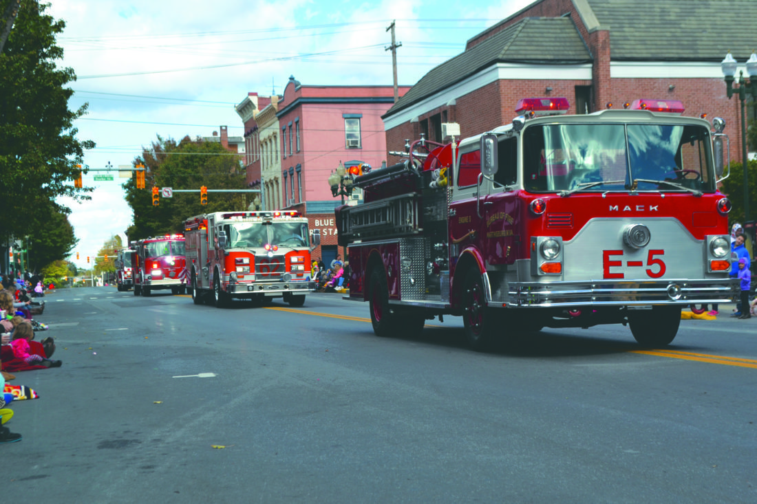 Journal photos by Mary Stortstrom Above, fire trucks roll down Queen Street as part of Martinsburg's annual Mountain State Apple Harvest Festival Parade on Saturday.