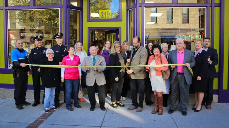 (Photo courtesy Sam McGovern/Martinsburg Police Department) A number of Martinsburg officials and businessowners attended a ribbon cutting Friday for Queen St. Antiques. Among those standing near the ribbon, from left, are Ptmn. Bill Parks, Martinsburg Police; Deputy Chief George Swartwood, Martinsburg Police; Gula Engle, Main Street Martinsburg; Chief Maury Richards, Martinsburg Police; Katie Palmer, City National Bank; Tina Dorsey, O'Party Plus; Mayor George Karos; Barbara Bratina, Main Street Martinsburg, Janie and Greg Henry, owners of Queen St. Antiques; Harriet Johnson, city councilmember at large; Ken Collinson, city councilmember, Ward 3; Tina Combs, president and CEO, Martinsburg-Berkeley County Chamber of Commerce; and Randy Lewis, executive director, Main Street Martinsburg.