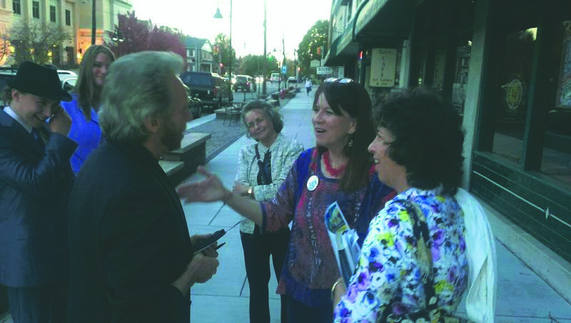 (Photo by Jeff Bright/West Virginia Public Broadcasting) Supporters Mac Halterman, Nikki Lower, Linda Jett, Gregg Braden and Liz Cantor-Bright meet with Charlotte Pritt, the Mountain Party candidate for West Virginia governor, recently at the Star Theatre in Berkeley Springs.