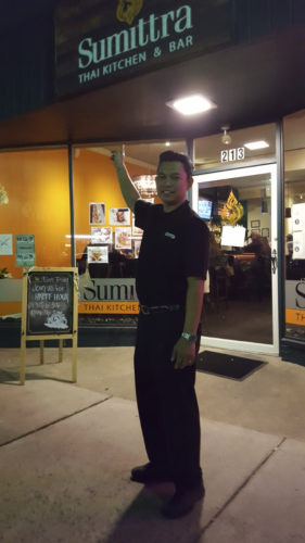 (Photo by Jennifer R. Young) Jittisak Phakam, owner of Sumittra, a Thai restraurant he opened in Charles Town and named after his wife, is shown standing in front of his restraunt, located at 213 W. Washington St.