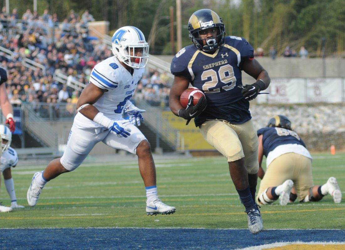 Shepherd running back Deonte Glover runs past Asuumption's Charles Reid for a first-quarter touchdown in the Rams' win. (Journal photo by Ron Agnir)