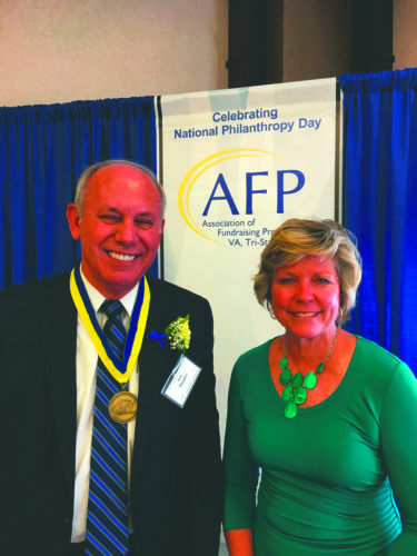 (Submitted photo) Lee Snyder, left, was honored by the Association of Fundraising Professionals Tri-State Chapter as the Individual Philanthropist of the Year during the organization's annual National Philanthropy Day luncheon. He was nominated by Hospice of the Panhandle and is shown with Hospice development director Maria Lorensen.