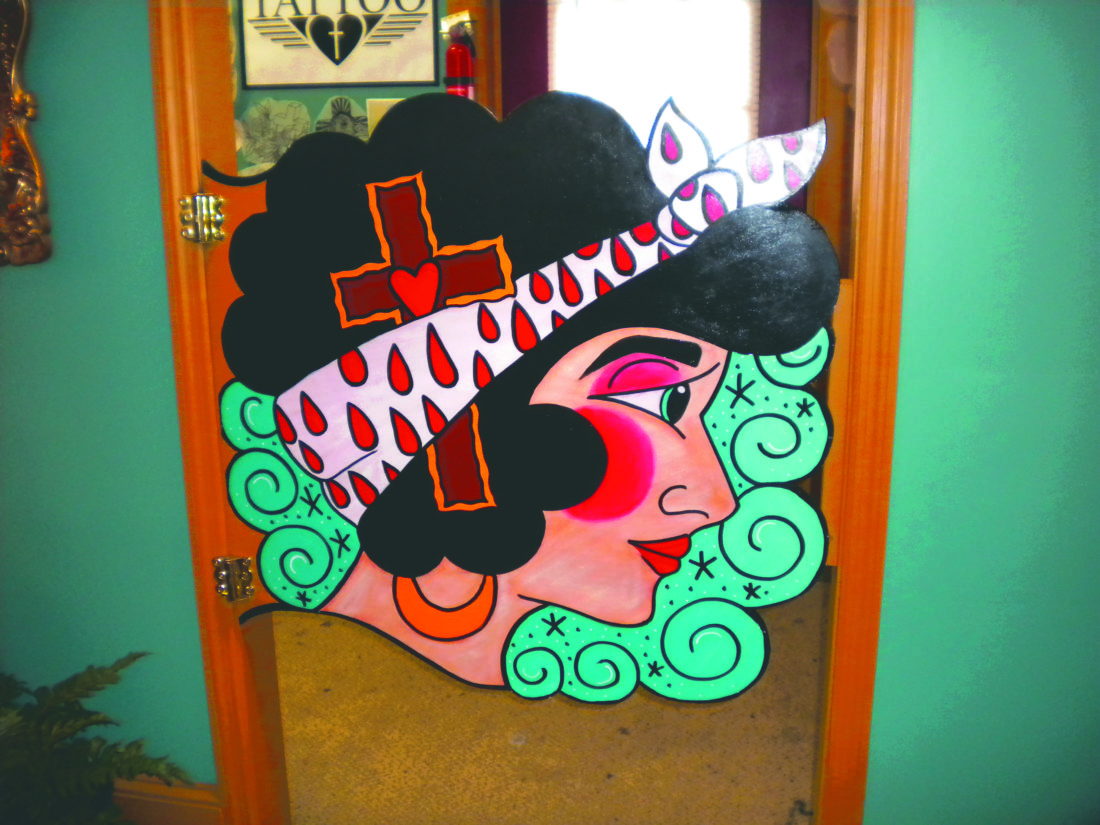 The door to Brandon Murphy's office/drawing room is shown decorated with some of Murphy's artwork at True Love Tattoo Parlor in Martinsburg.