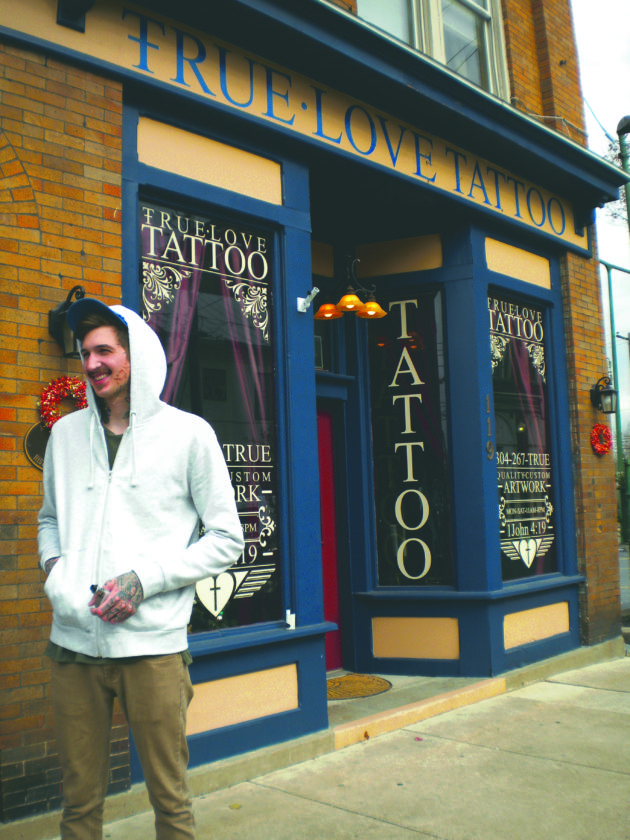 True Love Tattoo Parlor owner Brandon Murphy stands outside of his shop on East Martin Street in downtown Martinsburg.